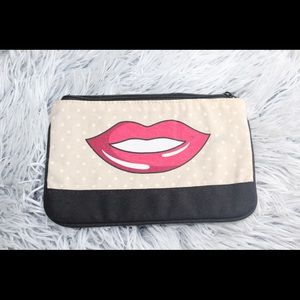 Small Ipsy makeup bag.